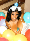playful-black-haired-girl-in-white-dress-gets-her-unbelievably-big-tits-out-while-posing-in-balloons