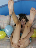 brunette-teen-shows-her-shaved-snatch-and-licks-her-tits-on-her-bed-among-balloons