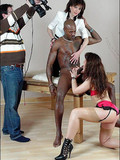 nude-black-guy-gets-his-hard-long-cock-touched-and-sucked-by-two-clothed-ladies
