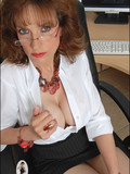 mature-four-eyed-secretary-poses-in-sheer-pantyhose-and-black-high-heel-shoes