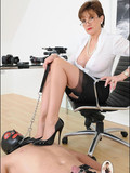 four-eyed-mature-secretary-punishes-masked-man-on-the-floor-at-the-office