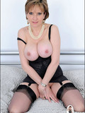 busty-mature-seductress-with-bald-pussy-opens-her-stocking-clad-legs-with-no-shame