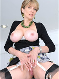 naughty-mature-poser-lady-sonia-in-nylons-and-skirt-shows-off-her-neat-smooth-pussy