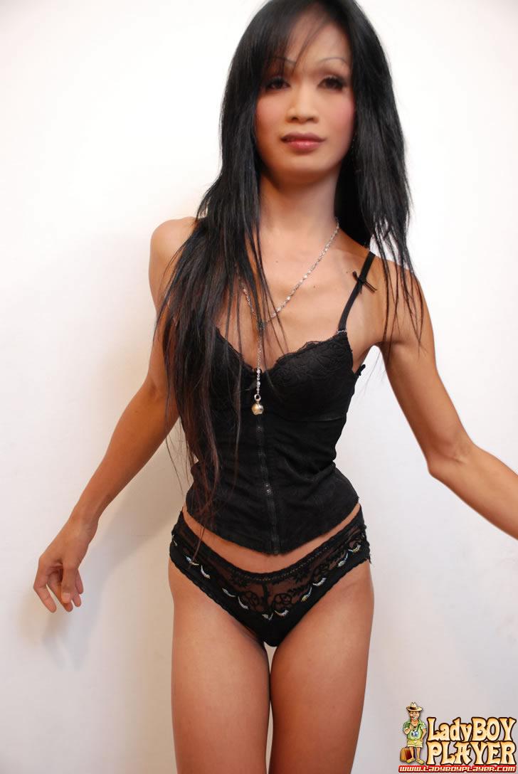 petite ladyboy Petite ladyboy pulls down her black panties and flashes her oriental cock