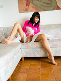 fabulously-beautiful-raven-haired-ladyboy-dressed-in-pink-and-white-exposes-her-sexy-legs