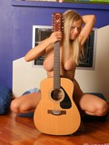 guitar-and-well-shaped-body-of-this-blonde-look-absolutely-turning-on-and-exciting