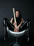 dark-angel-dressed-in-black-latex-suit-fucks-her-shaved-loose-cunt-with-big-baseball-bat