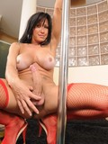 big-boobed-transsexual-pole-dancer-dressed-in-red-shows-it-all-with-no-shame