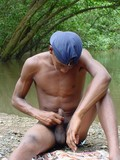 dark-skinned-latin-guy-strips-somewhere-in-the-woods-eager-to-stroke-and-milk-his-cock