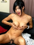 long-legged-asian-tranny-girl-gets-nude-then-exposes-her-round-boobs-and-dick