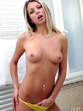 magnificent-blonde-lea-tyron-strips-down-to-her-yellow-lingerie-and-shows-her-firm-tits