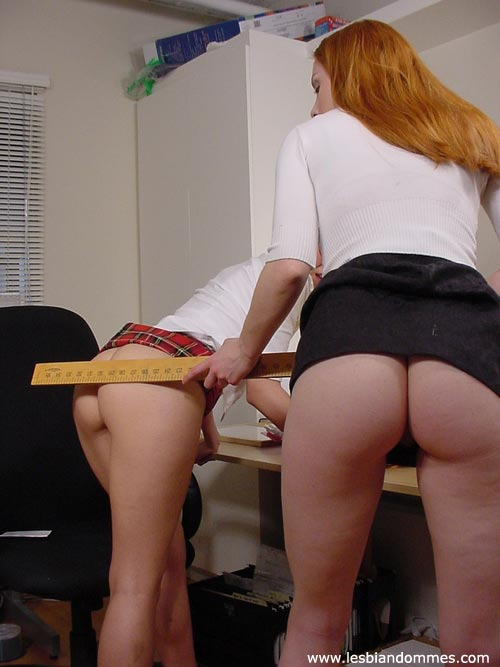Dominating brunette smothers a redhead