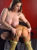 bare-assed-girl-in-green-stockings-gets-whipped-by-topless-huge-titted-brunette