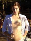 red-haired-country-girl-with-beautiful-ass-and-tattooed-back-gets-nude-at-the-farm