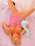 tender-blonde-girl-in-pink-nightie-removes-her-panties-and-shows-her-hairless-snatch