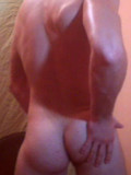 oiled-up-strong-webcam-guy-poses-in-tight-white-briefs-and-flashes-his-ass