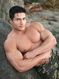 incredibly-strong-man-with-big-iron-muscles-poses-outdoors-and-shows-his-nice-bare-ass
