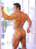 big-handsome-bodybuilder-poses-in-sexy-jocks-making-no-secret-of-his-hot-ass