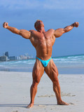white-haired-bodybuilder-with-killer-body-puts-on-an-amazing-muscle-show-outdoors