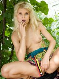 blonde-hottie-in-dress-playfully-demonstrates-her-tits-and-bare-pussy-in-the-garden