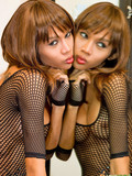 leggy-slim-tranny-in-short-black-fishnet-dress-plays-with-dildo-in-front-of-the-mirror