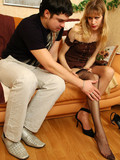 tall-high-heeled-blonde-in-brown-dress-and-black-stockings-gets-stuffed
