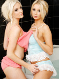 Two slim blonde haired british lesbian glam ladies pose naked in the bathtub