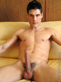Nude dark haired guy makes his eyes on you as he demonstrates his big solid cock