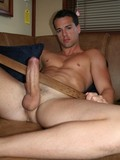 handsome-naked-man-with-charming-smile-proudly-displays-his-hard-meaty-cock