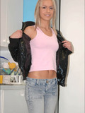 angelic-teen-blonde-goes-topless-then-pulls-down-her-blue-jeans-leaving-her-thong-on