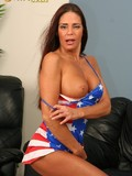 leggy-american-babe-in-short-patriotic-dress-shows-her-tiny-red-thong-panties-and-big-tits