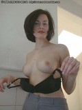 black-haired-starlet-shyly-removes-her-black-bra-and-displays-her-fine-tits
