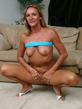 suntanned-milf-in-green-skirt-shows-her-naughty-bits-before-getting-face-fucked