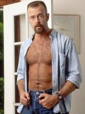 hairy-bearded-mature-dude-strips-and-shows-his-tanlined-ass-and-semi-hard-cock