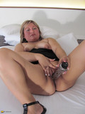 sex-hungry-fair-haired-mature-inserts-dildo-deep-in-her-shaved-meaty-pussy