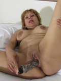breasty-mature-woman-takes-off-her-yellow-panties-to-fuck-her-needy-pussy-with-dildo