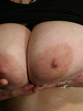 chubby-mature-strips-her-huge-panties-then-bares-her-massive-tits-and-licks-her-own-nipples