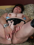 thick-mature-brunette-in-boots-and-mini-skirt-takes-dildo-up-her-eager-pussy