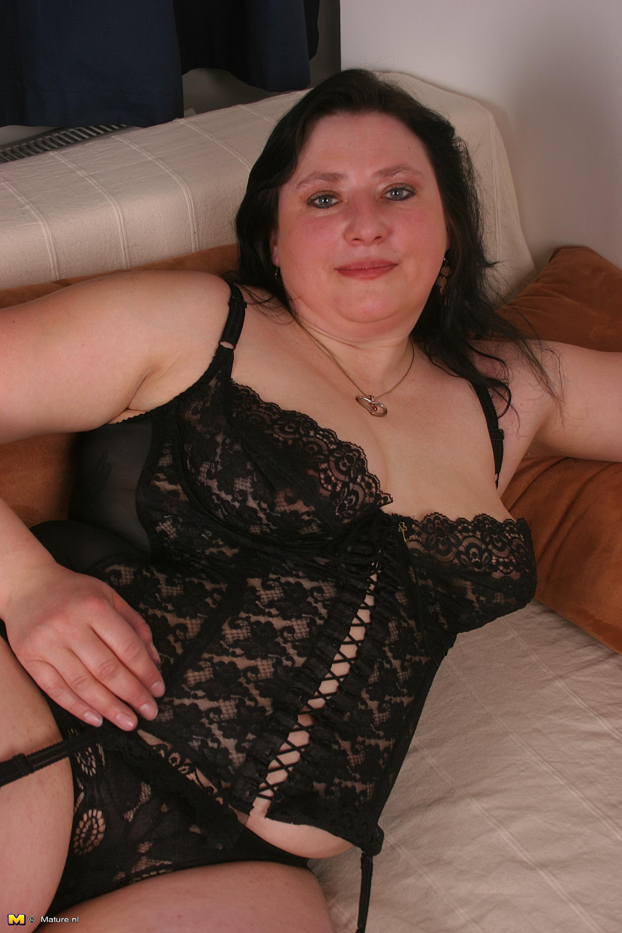 Mature Chubby Hairy Pussy - Experienced thick brunette in black lingerie spreads her hairy mature pussy