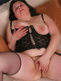 experienced-thick-brunette-in-black-lingerie-spreads-her-hairy-mature-pussy