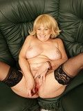 blonde-haired-mature-in-black-nylon-stockings-stimulates-her-ass-and-pussy-with-sex-toys