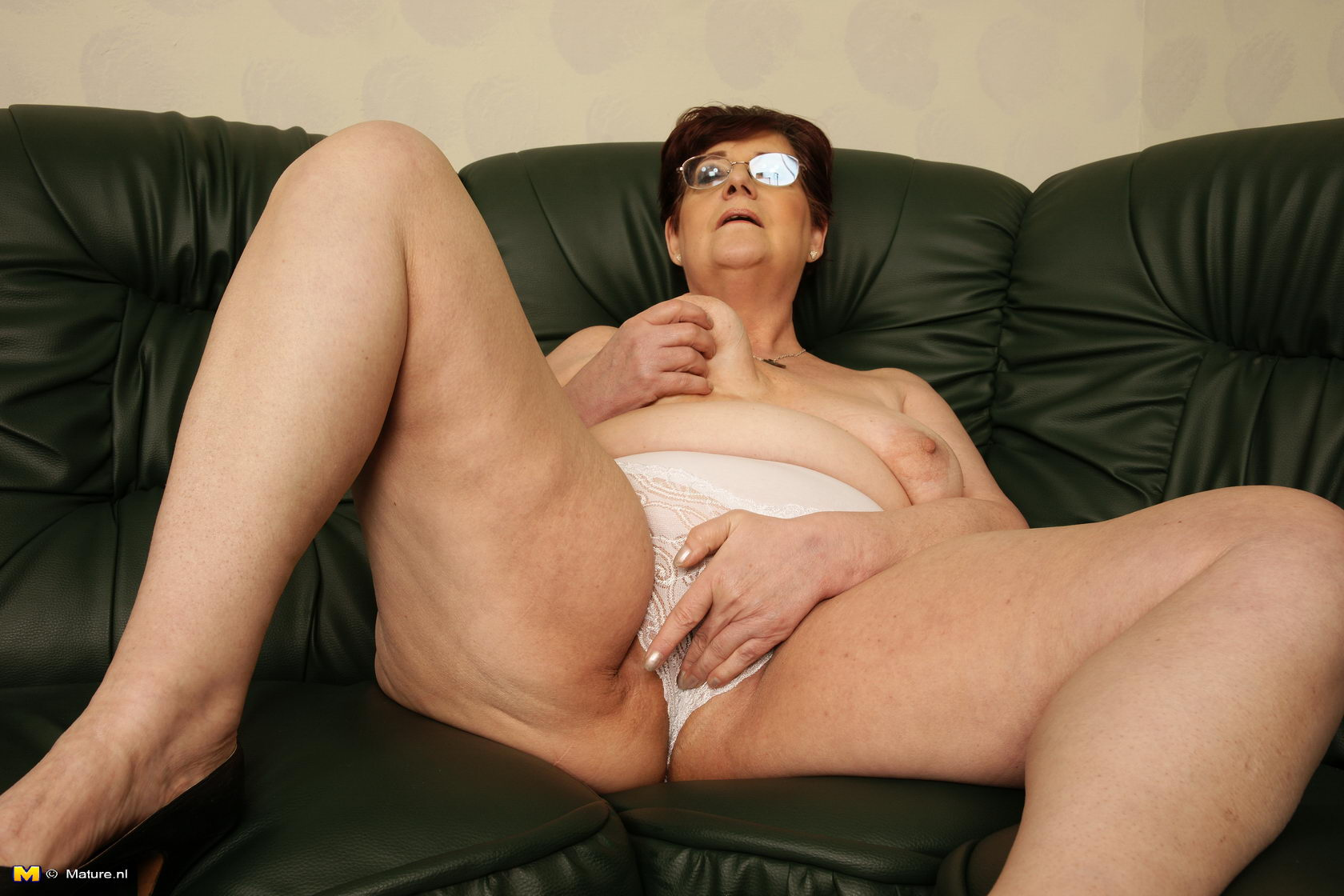 fat spectacled mature lady in white blouse and black skirt gets
