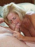 big-breasted-granny-gets-her-shaved-pussy-tongue-fucked-in-the-middle-of-a-big-bed
