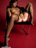 killer-hot-bimbo-in-stockings-performing-the-sexy-poses-in-and-on-the-chair
