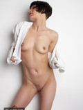 skinny-flirtatious-brunette-with-tiny-ass-and-tits-strips-out-of-white-shirt-on-camera