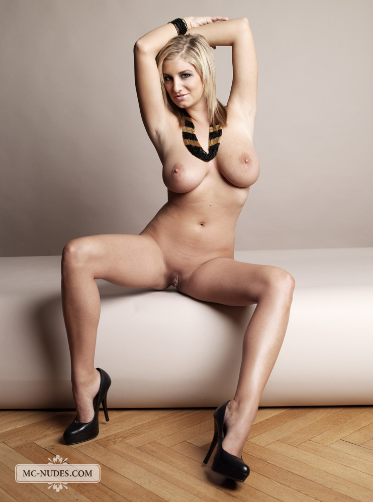 Slim blonde temptress with big boobs and hairless snatch poses ...