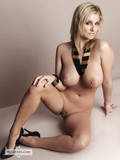 slim-blonde-temptress-with-big-boobs-and-hairless-snatch-poses-naked-in-high-heels
