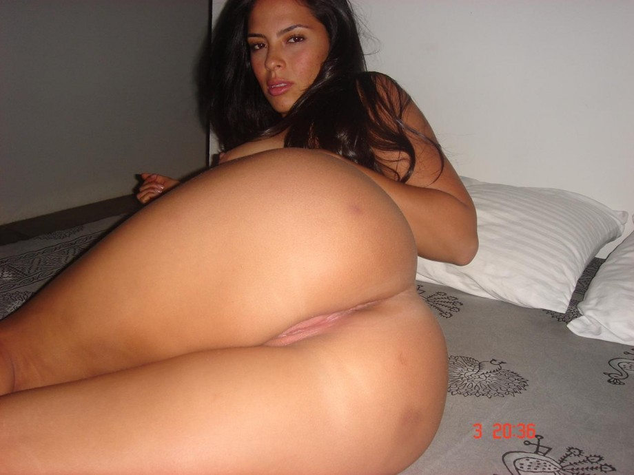 naked completely nude amateur latina shows off her shaved snatch and