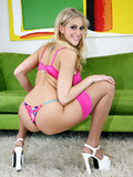 big-racked-blonde-dressed-in-pink-gets-her-ass-stuffed-on-a-green-couch