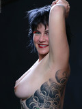 brunette-haired-fetish-lady-michelle-aston-poses-nude-and-shows-all-her-tattoos